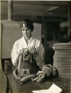 A woman assembles gas masks during World War I in the United States
