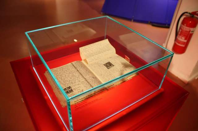 The Diary of Anne Frank enclosed in a glass box