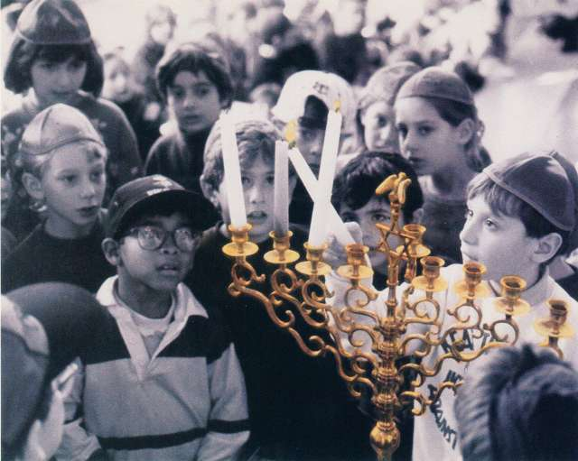 Children lighting a menorah.