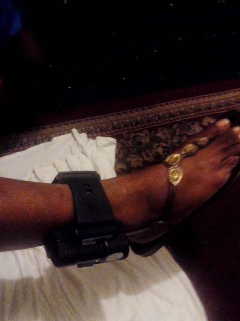 A GPS-monitored ankle bracelet on an ankle.