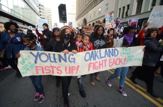 Millennial activists participate in the Millions March in Oakland. Credit: Creative Commons/Daniel Arauz.