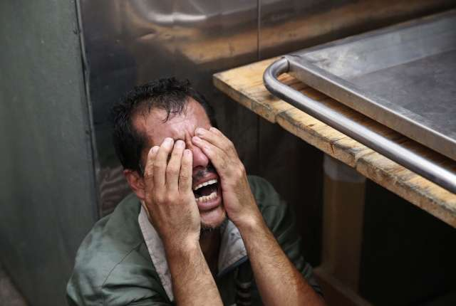 A Palestinian man crying.