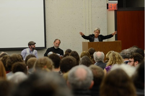 Judith Butler standing at a podium speaking to Open Hillel conference audience.