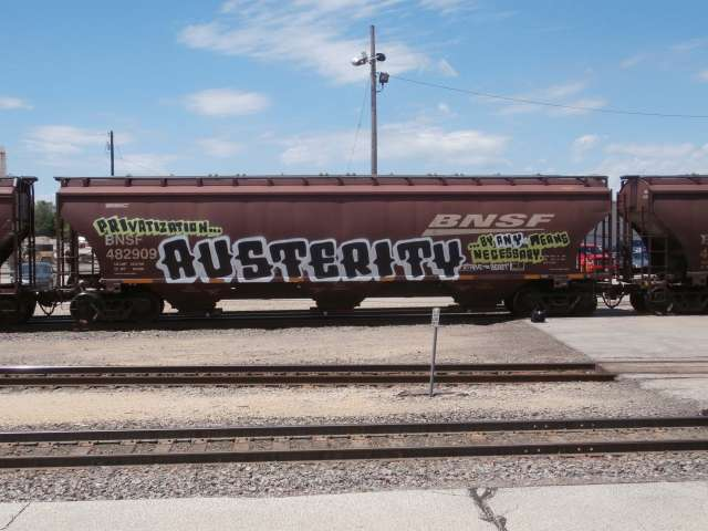 "Train car with the word ""austerity"" graffitied on it."