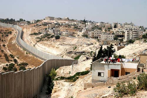 A fence between Israeli and Palestinian settlements.