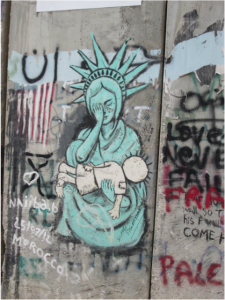 Graffiti of a crying Statue of Liberty
