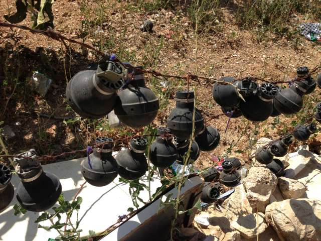 Tear gas canisters.