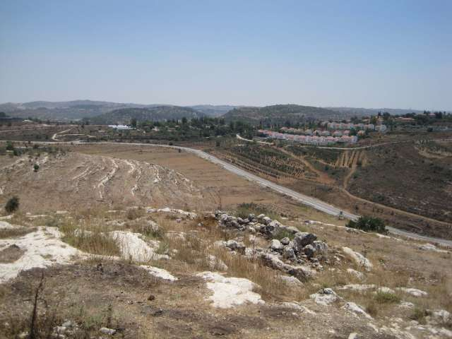 Landscape of barren farm land of Nabi Saleh (to the left) and Halamish Settlement (to the right).