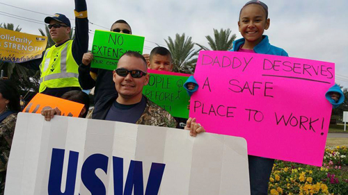 A family carrying picket signs.