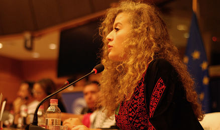 Ahed Tamimi speaking at a conference