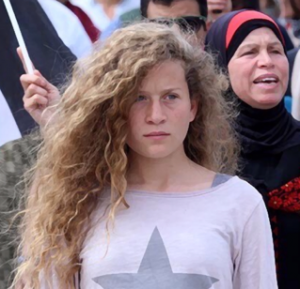 Image of Ahed Tamimi standing in front of a group of people