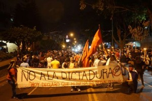 Hondurans march in non-violent demonstration at the U.S. Embassy, Sunday, Jan. 28, in opposition to installation of president Juan Orlando Hernández.