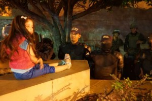 Child sits while police stare at her in Honduras