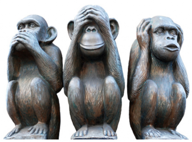 Three monkeys, one covering its mouth, another its eyes, another its ears