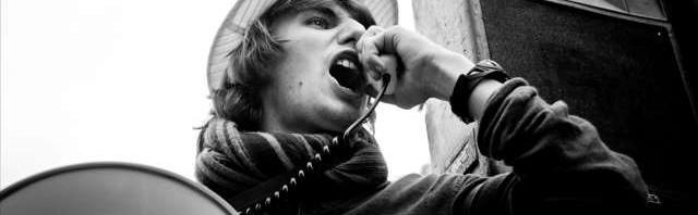 Man yells into megaphone speaker