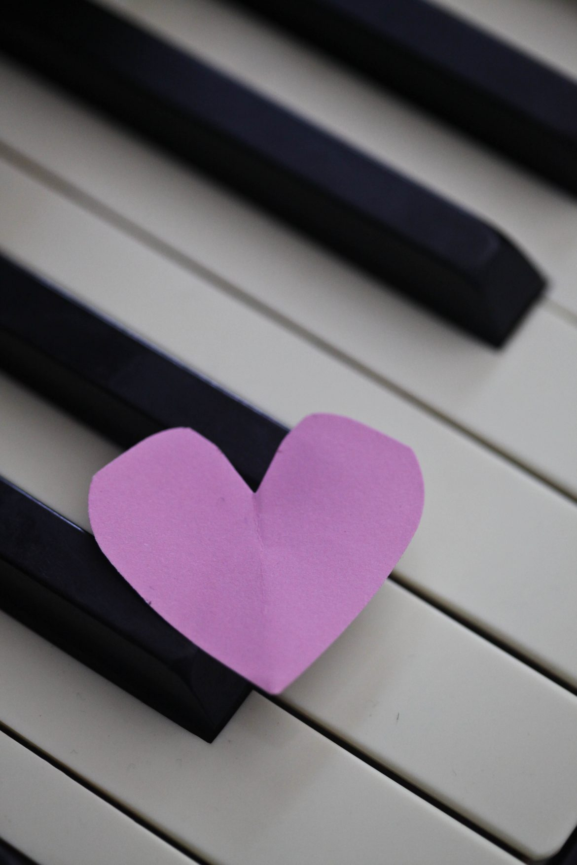 cut out paper heart on keyboard
