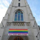 church with LGBTQ flag hanging in front