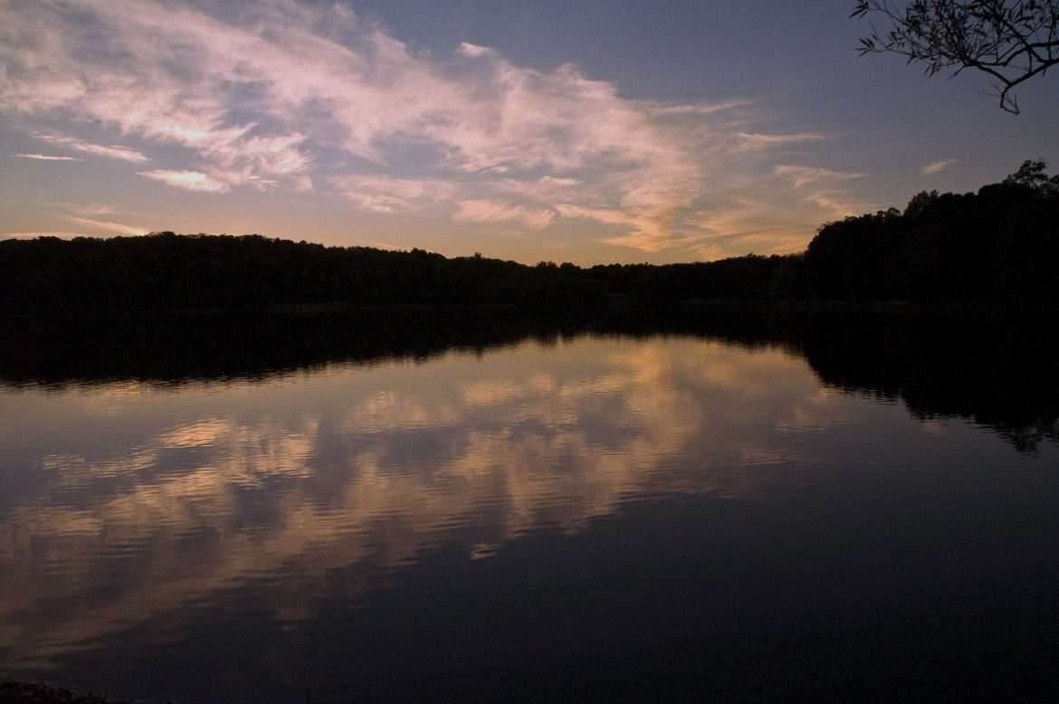 image of clear pond wit sunset