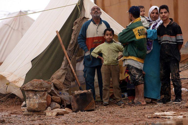 "Photo: ""Palestinian Iraqi IDP family near Jordanian border"" Graham A. Paulsgrove, 2006; Wikimedia Commons"